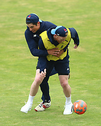 England's Alastair Cook (left) and Ben Stokes during a nets session at Headingley, Leeds.