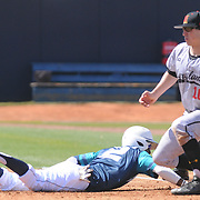 UNCW's Zach Shields safely tags back to first as Maryland's Justin Morris covers Sunday March 8, 2015 at Brooks Field. (Jason A. Frizzelle)