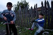 Bekan Khancoshvili  (8) plays with his friend. Duisi, Republic of Georgia.