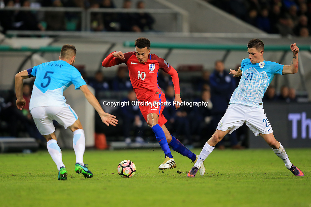 11 October 2016 - FIFA 2018 World Cup Qualifying (Group F) - Slovenia v England - Dele Alli of England in action with Bostjan Cesar and Benjamin Verbic of Slovenia - Photo: Marc Atkins / Offside.