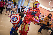 11 MAY 2014 - BANGKOK, THAILAND:   A boy dressed as Captain America and a man dressed as Iron Man at Thailand Comic Con at Siam Paragon Mall in Bangkok.  PHOTO BY JACK KURTZ