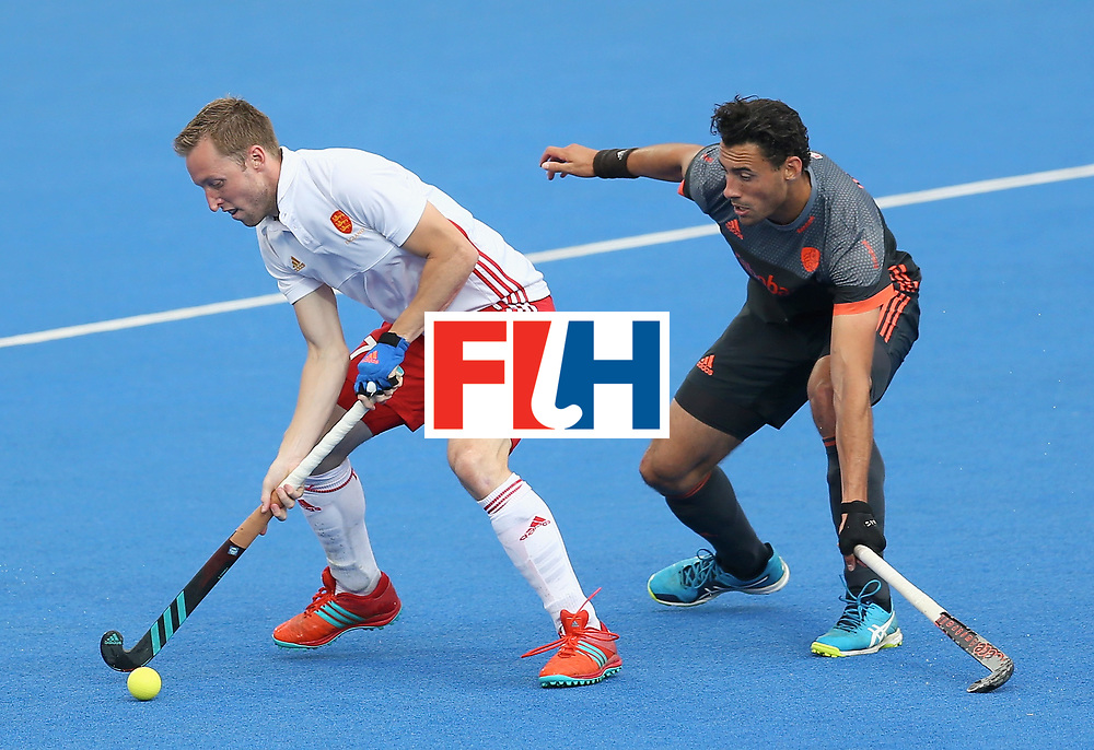LONDON, ENGLAND - JUNE 24:  Ian Sloan of England and Glenn Schuurman of the Netherlands battle for possession during the semi-final match between England and the Netherlands on day eight of the Hero Hockey World League Semi-Final at Lee Valley Hockey and Tennis Centre on June 24, 2017 in London, England.  (Photo by Steve Bardens/Getty Images)