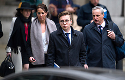 © Licensed to London News Pictures. 21/01/2016. London, UK.ANATOMY (front holding blue folder) , son of  MARINA LITVINENKO leaving The High Court in London after a report into the killing of Alexander Litvinenko was released. Alexander Litvinenko was poisoned with the radioactive isotope polonium-210  in London. Photo credit: Ben Cawthra/LNP