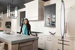 Jennifer Gilmer in her showroom Ad for Gramaco Stone