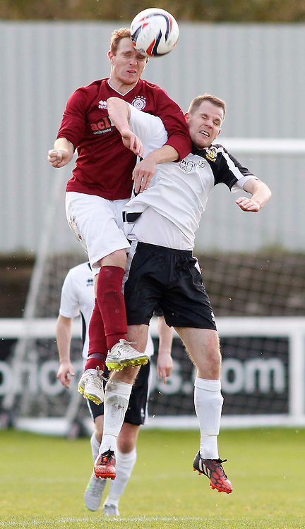 Blair Batchelor of Linlithgow beats Clach's Martin Callum in the air<br /> in the Scottish Cup 2nd Round Match at Grant Street Park(c) Andrew West | SportPix.org.uk