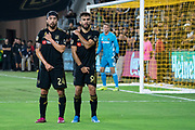 LAFC midfielder Lee Nguyen (24) and forward Diego Rossi (9) wait a free kick against the Houston Dynamo during a MLS soccer game, Saturday, Sept 25, 2019, in Los Angeles. LAFC wins 3-1. (Jon Endow/Image of Sport)