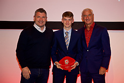 NEWPORT, WALES - Saturday, May 19, 2018: Dan Malone is presented with his cap by Osian Roberts (left) and Ian Rush (right) during the Football Association of Wales Under-16's Caps Presentation at the Celtic Manor Resort. (Pic by David Rawcliffe/Propaganda)