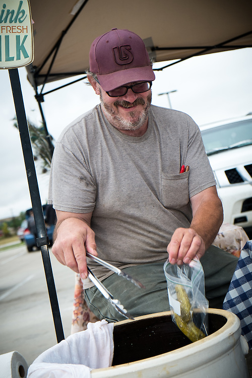 Frank Wallis, Owner of Easy Easy Rocking Ranch and Wyoming Grass Fed bags pickles to sell at the, Gillette Farmer's Market | August 23, 2014