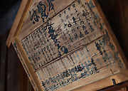 """Photo shows an original """"hengaku"""" -- or program -- which hang on the walls of Korakukan theater, Japan's oldest extant wooden playhouse in Kosaka, Akita Prefecture Japan on 19 Dec. 2012. The wooden hengaku were used at a time when paper was less widely available and the program from the very first kabuki performance at the playhouse in 1910 survives to this day. Photographer: Rob Gilhooly"""