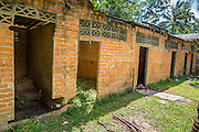 29 OCTOBER 2012 - MAYO, PATTANI, THAILAND:   Patient housing, some dilapidated, at the Bukit Kong home in Mayo, Pattani. The home opened 27 years ago as a ponoh school, or traditional Islamic school, in the Mayo district of Pattani. Shortly after it opened, people asked the headmaster to look after individuals with mental illness. The headmaster took them in and soon the school was a home for the mentally ill. Thailand has limited mental health facilities and most are in Bangkok, more than 1,100 kilometers (650 miles) away. The founder died suddenly in 2006 and now his widow, Nuriah Jeteh, struggles to keep the home open. Facilities are crude by western standards but the people who live here have nowhere else to go. Some were brought here by family, others dropped off by the military or police. The home relies on donations and gets no official government support, although soldiers occasionally drop off food. Now there are only six patients, three of whom are kept chained in their rooms.  Jeteh says she relies on traditional Muslim prayers, holy water and herbal medicines to treat the residents. Western style drugs are not available and they don't have a medic on staff.   PHOTO BY JACK KURTZ