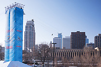 Minneapolis, MN - January 27, 2017: Bold North Zip Line participants zoom down the line and over the Mississippi River as part of the SuperBowl LII events taking place in Minneapolis.