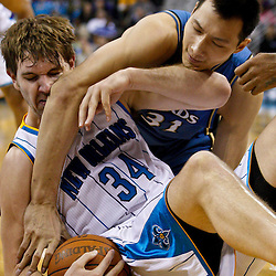 February 1, 2011; New Orleans, LA, USA; New Orleans Hornets center Aaron Gray (34) and Washington Wizards power forward Yi Jianlian (31) scramble for a loose ball during the fourth quarter at the New Orleans Arena.   Mandatory Credit: Derick E. Hingle