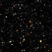 The Hubble Ultra Deep Field, is an image of a small region of space in the constellation Fornax, composited from Hubble Space Telescope data accumulated over a period from September 3, 2003 through January 16, 2004. The patch of sky in which the galaxies reside was chosen because it had a low density of bright stars in the near-field.