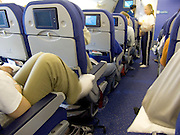 passenger resting during flight in commercial airplane economy class