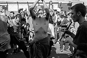 Shirtless protestor dancing, Reclaim the Streets, Shepherd's Bush, London, July 1996