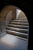 Detail of a roman archway and stairs in the Coliseum in Arles, France.