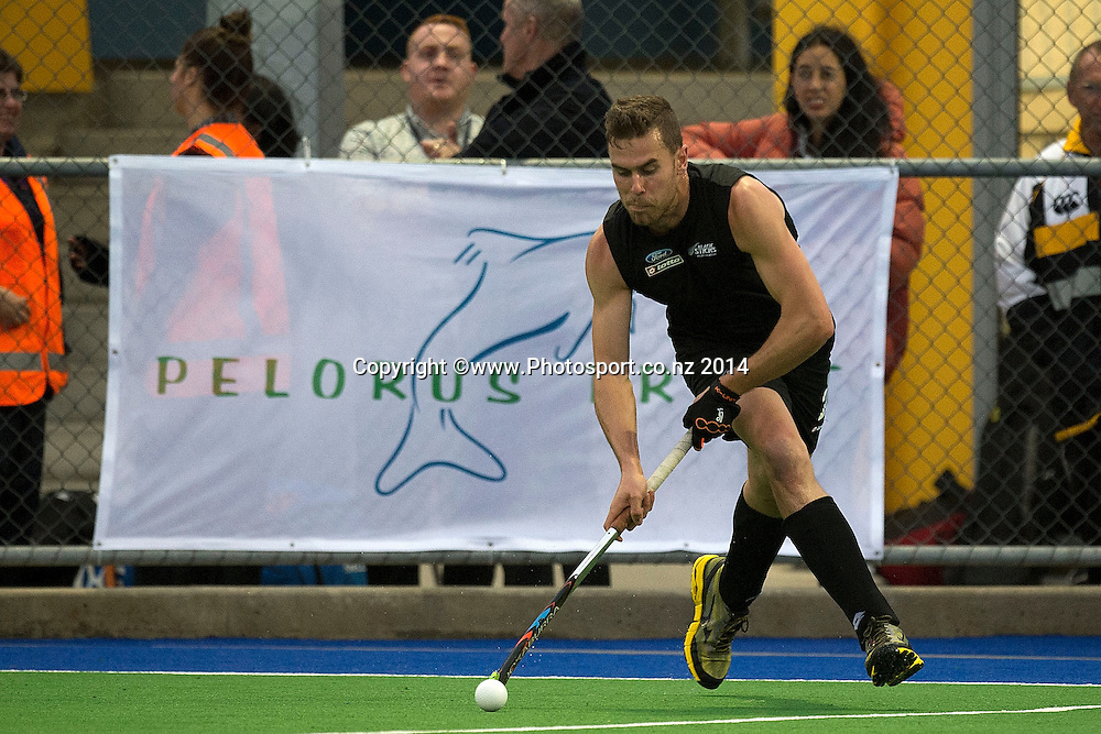 Cory Bennett of New Zealand looks to pass during the Black Sticks Men v Japan international hockey match at the Coastlands Kapiti Sports Turf in Paraparaumu on Friday the 21st of November 2014. Photo by Marty Melville/www.Photosport.co.nz