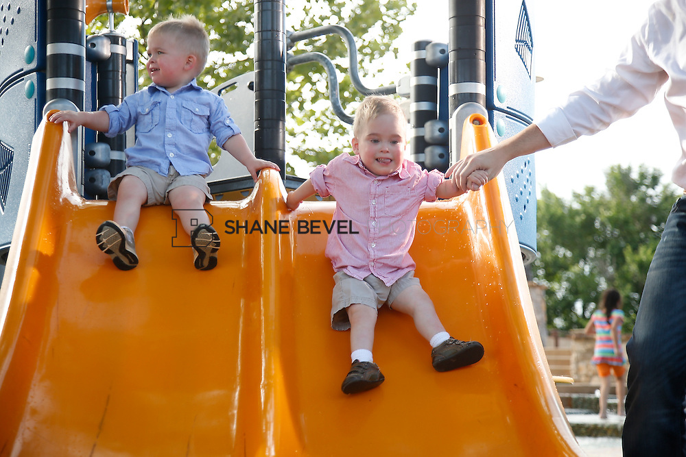 5/28/15 6:04:09 PM -- Miracle Miles and his family pose for portraits and play at the QuikTrip park for the 2015 Saint Francis Health System advertising campaign. <br /> <br /> Photo by Shane Bevel