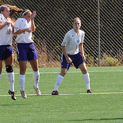 Photos by Tom Kelly IV<br /> WCU's Carly Yost (7) stops a penalty shot with her back as she jumps with her teammates as IUP's Adriana Konstantinides (38) looks on during the Indiana University of Pennsylvania (IUP) vs West Chester University (WCU) women's soccer game in East Bradford Township, Wednesday afternoon October 2, 2013.