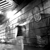Philadelphia, PA - December 3, 2014.  Pedestrians pass in front of a mural completed in 2000 themed for father's day features Bill Cosby (right), Martin Luther King Jr., Malcolm X, Nelson Mandela, Desmond Tutu, etc.  Allegations that Bill Cosby sexually assaulted numerous women over the past decades.  CREDIT: Mark Makela for The New York Times
