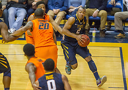 West Virginia Mountaineers guard Jevon Carter (2) tries to drive baseline against the Oklahoma State Cowboys during the second half at the WVU Coliseum.