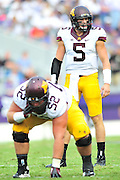 FORT WORTH, TX - SEPTEMBER 13:  Chris Streveler #5 of the Minnesota Golden Gophers reads the defense against the TCU Horned Frogs on September 13, 2014 at Amon G. Carter Stadium in Fort Worth, Texas.  (Photo by Cooper Neill/Getty Images) *** Local Caption *** Chris Streveler