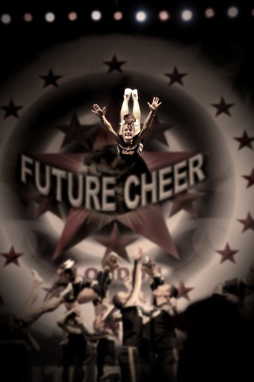 A flyer for Unity Allstars Black SOCO6 performing a front stall / bird front basket toss at the Future Cheer Nationals in their Grand Championship winning routine