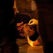 Egyptian medical staff treat an injured protestor in a makeshift clinic near Tahrir Square in central Cairo.