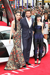 © Licensed to London News Pictures. Tao Okamoto, Hugh Jackman, Rila Fukashima at The Wolverine UK film premiere, Leicester Square, London UK, 16 July 2013. Photo by Richard Goldschmidt/LNP