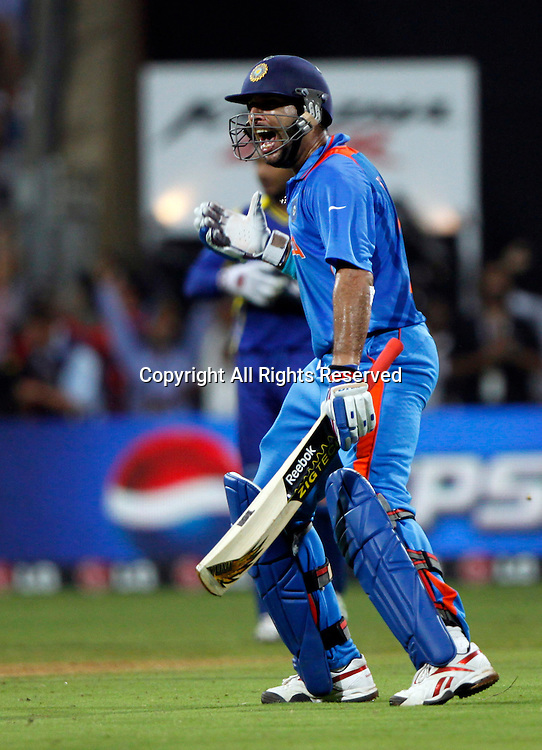 02.04.2011 Cricket World Cup Final from the Wankhede Stadium in Mumbai. Sri Lanka v India. Yuvraj Singh of India celebrates  as they win the final match of the ICC Cricket World Cup between India and Sri Lanka on the 2nd April 2011