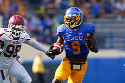 September 24, 2011; San Jose, CA, USA;  San Jose State Spartans running back Brandon Rutley (9) rushes past New Mexico State Aggies defensive tackle David Mahoney (98) during the fourth quarter at Spartan Stadium. San Jose State defeated New Mexico State 34-24.