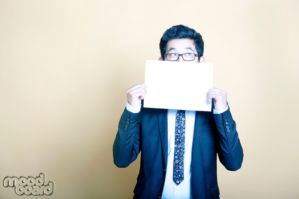 Asian businessman holding white blank sign