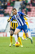Chris McCann of Wigan Athletic beats Larnell Cole of Shrewsbury Town during the Sky Bet League 1 match at the DW Stadium, Wigan<br /> Picture by Matt Wilkinson/Focus Images Ltd 07814 960751<br /> 21/11/2015
