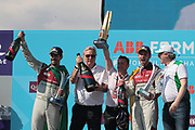 ALAN McNISH, Team Manager AUDI formula E - the Team trophy for best performance in the 2018 season has been handed to ALAN McNISH, Team Manager AUDI formula E - podium celebration with Champaign by team AUDI SPORT - ABT Schaeffler drivers Luca di Grassi and Daniel ABT. and with CEO Schaeffler Prof. Dr.-Ing. Peter Gutzmer: Vorstand Technologie, and Georg F. W. Schaeffler  (R) <br /> USA e-Prix, FIA Formula E, Formula E Grand Prix at the red hook Brooklyn New York harbor area on 15 July, 2018. Formel E in New York, Brooklyn, Red Hook port area. <br /> fee liable image, copyright@ ATP Arthur THILL