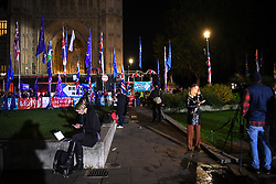 "© Licensed to London News Pictures. 22/10/2019. London, UK. Media outlets broadcast live as people gather outside The Palace of Westminster in front of College Green following crucial votes for PM Boris Johnson government. MPs backed his Withdrawal Agreement Bill - but minutes later voted against the timetable, placing Brexit ""in limbo"". Photo credit: Guilhem Baker/LNP"