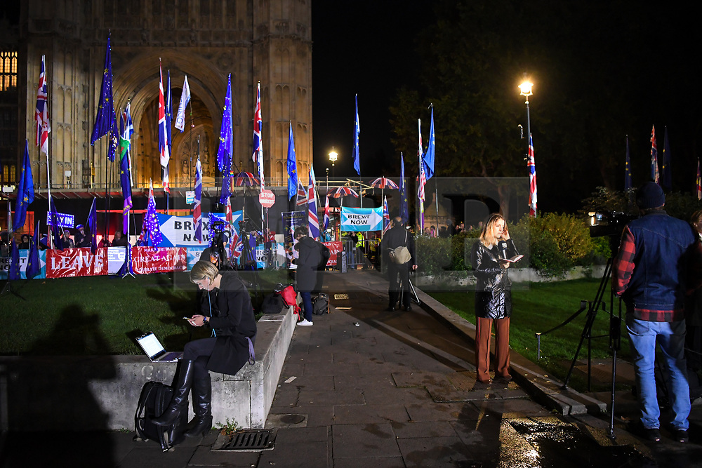 """© Licensed to London News Pictures. 22/10/2019. London, UK. Media outlets broadcast live as people gather outside The Palace of Westminster in front of College Green following crucial votes for PM Boris Johnson government. MPs backed his Withdrawal Agreement Bill - but minutes later voted against the timetable, placing Brexit """"in limbo"""". Photo credit: Guilhem Baker/LNP"""