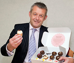 Atteys Solicitor Steve Taylor prepares to test the new Atteys Cup Cakes...7th September2011 Image © Paul David Drabble