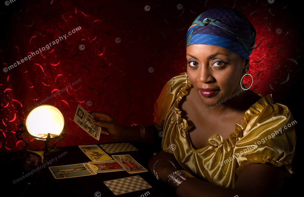 Fortune teller with Tarot cards and crystal ball