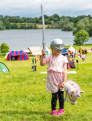 Pictured: Jousting at Linlithgow Palace. Linlithgow Palace, West Lothian, Scotland, United Kingdom, 30 June 2019. Historic Environment Scotland present their annual Medieval family day at The Peel at the grounds of the ruined 15th century castle. Events include a Living Medieval Village, a children's army schiltron, Falconry display by Strathblane Falconry and spectacular jousting. Bella, aged three years gets into the medieval spirit. She has been coming to the event since she was 14 months old.<br /> <br /> Sally Anderson | EdinburghElitemedia.co.uk