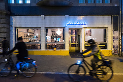 Exterior of Fleischerei restaurant at night in Prenzlauer Berg in Berlin Germany
