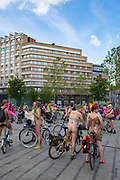 "World Naked Bike Ride Brussels 2013. The World Naked Bike Ride (WNBR) is an international clothing-optional bike ride in which participants plan, meet and ride together en masse on human-powered transport to ""deliver a vision of a cleaner, safer, body-positive world."""