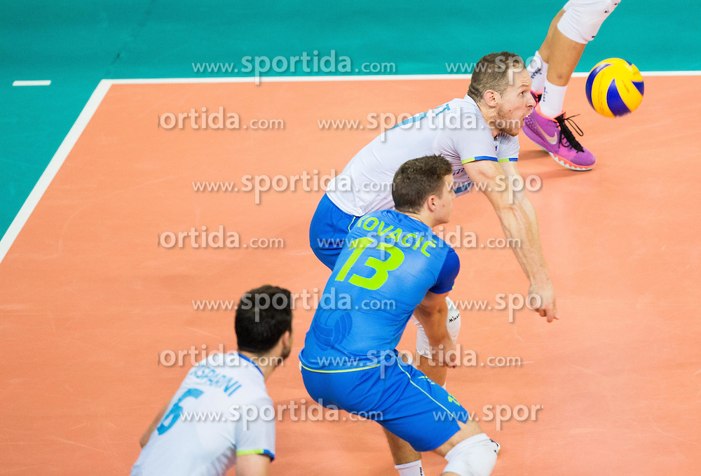 Jani Kovacic #13 of Slovenia and Tine Urnaut #17 of Slovenia during volleyball match between National teams of Slovenia and Italy in 1st Semifinal of 2015 CEV Volleyball European Championship - Men, on October 17, 2015 in Arena Armeec, Sofia, Bulgaria. Photo by Vid Ponikvar / Sportida