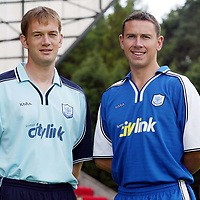 St Johnstone launch new strip and new sponsor 04.07.02<br />New signings John Robertson (right) models the new home strip alongside Ian Maxwell modelling the new away strip<br />see story by Gordon Bannerman Tel: 01738 493213 or contact Charles Mann on 0131 558 3111<br /><br />Picture by Graeme Hart.<br />Copyright Perthshire Picture Agency<br />Tel: 01738 623350  Mobile: 07990 594431