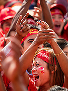 01 NOVEMBER 2015 - YANGON, MYANMAR: A woman laughs while Burmese comedians entertain the crowd at the NLD's last election rally of the 2015  election in the Yangon suburbs Sunday. Political parties are wrapping up their campaigns in Myanmar (Burma). National elections are scheduled for Sunday Nov. 8. The two principal parties are the National League for Democracy (NLD), the party of democracy icon and Nobel Peace Prize winner Aung San Suu Kyi, and the ruling Union Solidarity and Development Party (USDP), led by incumbent President Thein Sein. There are more than 30 parties campaigning for national and local offices.    PHOTO BY JACK KURTZ