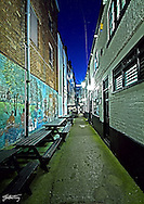 Having walked up and down the alley way several times, i settled on this angle for the shot.. I had tried many from the otherside of the ealleyway, but the sun brolleys really limited the detail in the brick work and sense of perspective. I was very keen to bring out the detail in the 'traditional' grafittion the left wall, while still getting the whitelocks sign within focus. As with several other exposures i took that night the sky was particuarly intriguing due to the historically full moon.  I love the depth of colour in the pavement, it gives it sense of age, yet still well used.
