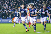 Millwall forward Matt Smith (10) celebrates with teammates after scoring a goal (2-1) during the EFL Sky Bet Championship match between Millwall and Charlton Athletic at The Den, London, England on 9 November 2019.