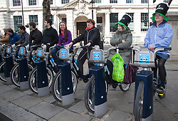© Licensed to London News Pictures. 18/03/2012. London, England. Waiting for the parade to arrive on Boris' Bikes. London celebrates St. Patrick's Day with a parade and festival. Photo credit: Bettina Strenske/LNP