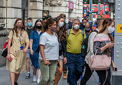 © Licensed to London News Pictures. 22/07/2020. London, UK. Commuters arrive in Westminster as they head to their offices in central London as figures released show more people are dying from the flu and pneumonia in England and Wales while the high street is still struggling with lack of footfall as the coronavirus pandemic continues. Last week Prime Minister Boris Johnson urged Britons to return back to working in offices to help service industries and the economic recovery. Photo credit: Alex Lentati/LNP