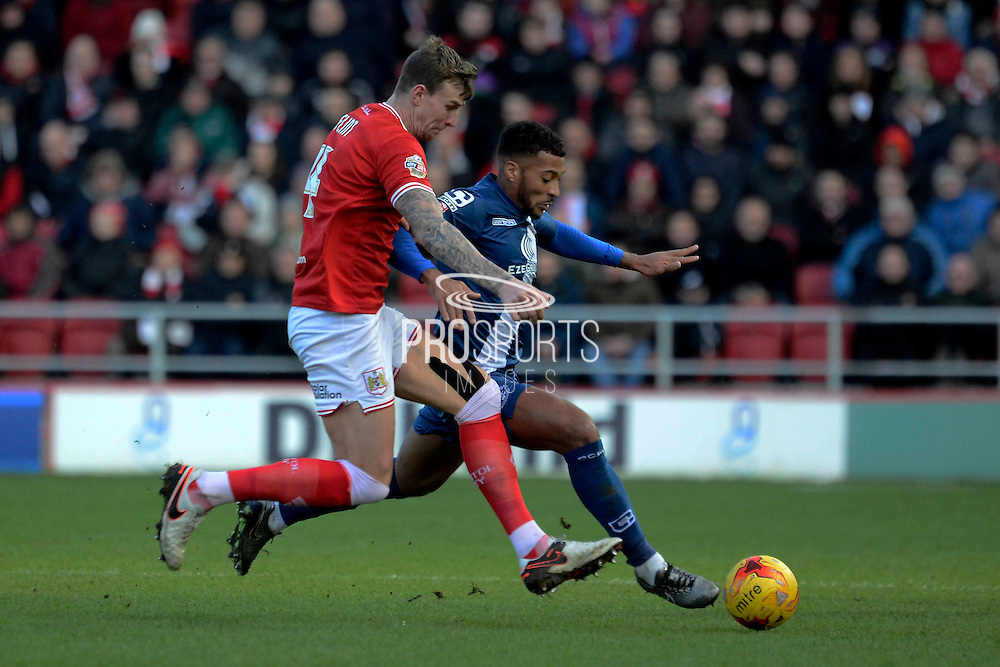 Bristol City defender Aden Flint challenges Birmingham City midfielder David Davis during the Sky Bet Championship match between Bristol City and Birmingham City at Ashton Gate, Bristol, England on 30 January 2016. Photo by Alan Franklin.