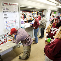 Adam Robison | BUY AT PHOTOS.DJOURNAL.COM<br /> Kossuth fans get their food from the concession stand Friday night before kickoff.